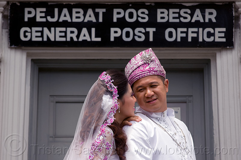 malay wedding - general post office (kuching), bouquet, bride, couple, groom, kuching, malay wedding, man, post office, sign, traditional wedding, wedding dress, woman