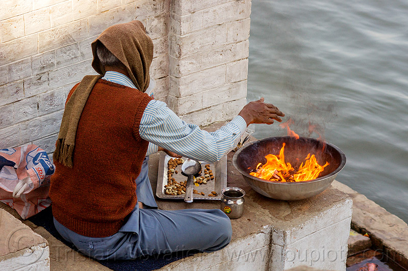 man burning hindu offerings on the ghats of varanasi (india), fire, flames, ganga, ganga river, ganges, ganges river, hinduism, people, sitting, water
