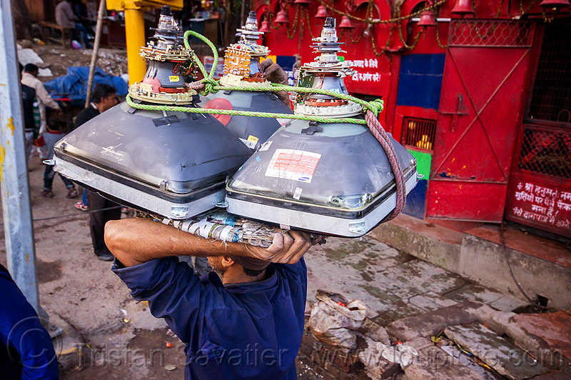 man carrying CRT screens on his head (india), bearer, carrying on the head, cathodic ray tubes, crt, delhi, electronics, india, man, porter, porting, recycling, rope, television, tv screens, wallah