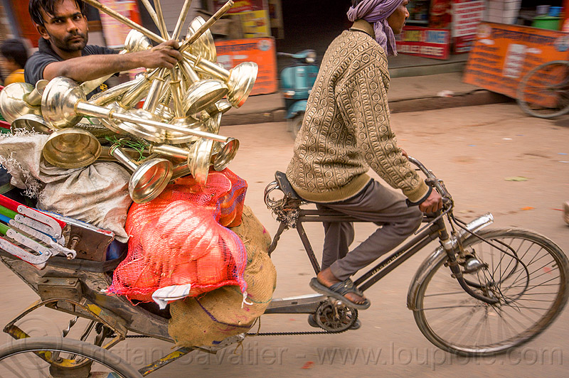 man carrying large objects on a cycle rickshaw, bags, cargo, carrying, cycle rickshaw, freight, india, men, moving, riding, sacks, varanasi
