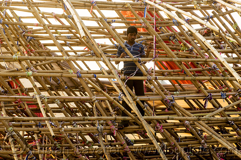 man in bamboo mesh structure (india), ashram, bamboo mesh, bamboo structure, broken, collapsed, destruction, gate, hindu pilgrimage, hinduism, india, maha kumbh mela