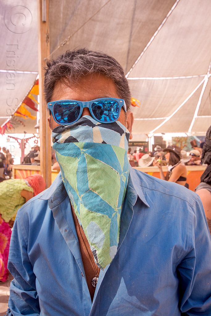 man in blue at center camp - burning man 2015, bandana, mirror sunglasses, people