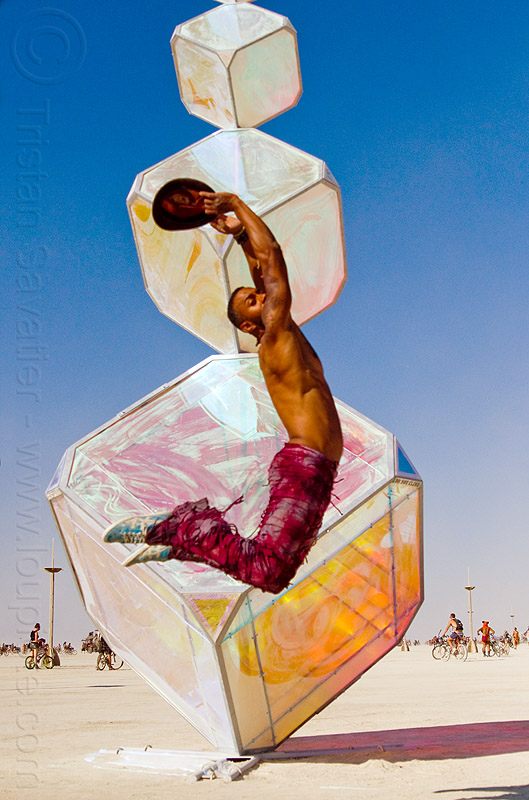 man jumping at iridescent cubes - burning man 2013, art installation, burning man, invisible, iridescent cubes, jumpshop, kirsten berg, sculpture