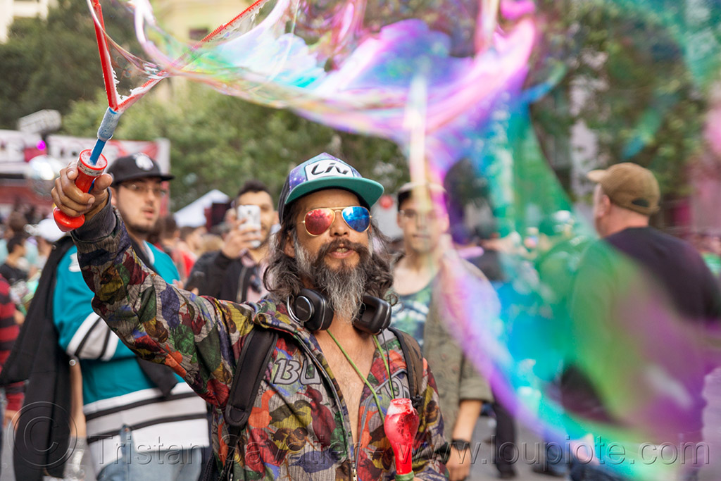 man making giant soap bubbles - how weird street faire (san francisco), beard, giant soap bubble, iridescent, man, sunglasses