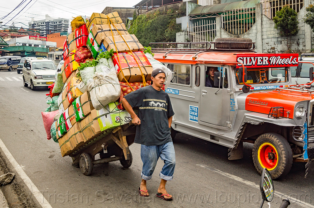 man pulling loaded hand cart on street (philippines), baguio, jeepney, man, philippines, produce, road, rolling, truck, vegetables, worker, working