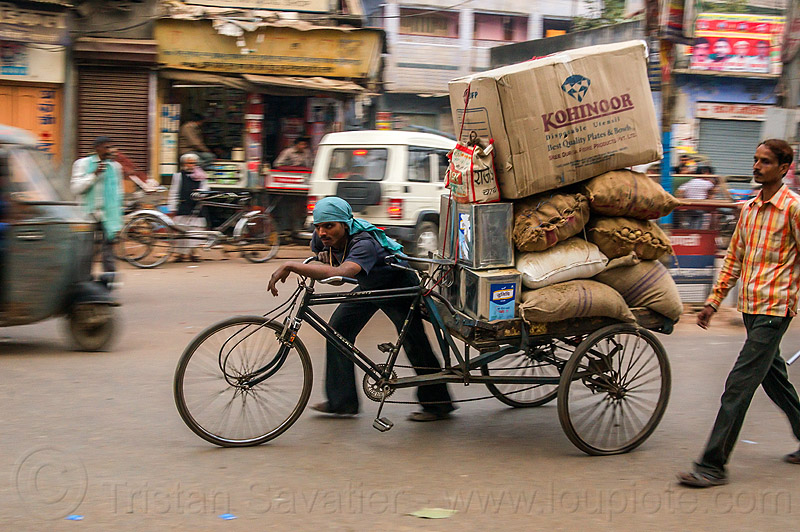 man pushing cargo tricycle with heavy load (india), bags, bearer, boxes, cargo tricycle, cargo trike, freight tricycle, freight trike, heavy, load, men, moving, pushing, sacks, street, transport, transportation, transporting, varanasi, walking