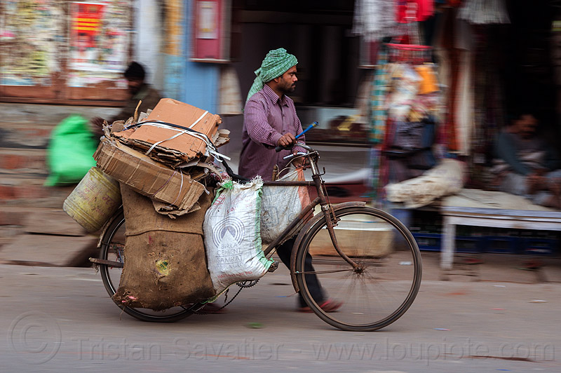 man pushing heavily loaded bicycle (india), bags, bearer, bicycle, bike, cargo, freight, headdress, headwear, heavy, load, man, moving, pushing, sacks, street, transport, transportation, transporting, varanasi, walking