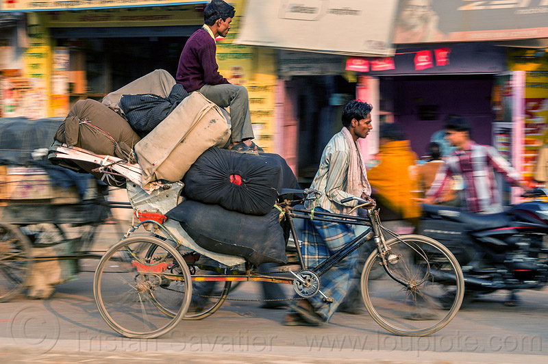 man sitting on top of large bags on cycle rickshaw (india), cargo, freight, heavy, load, men, moving, people, pushing, sacks, street, transport, transportation, transporting, varanasi, walking