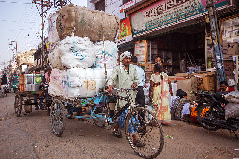 man walking cargo tricycle with heavy load of freight (india), bags, bearer, cargo trike, freight tricycle, freight trike, moving, people, pushing, sacks, street, transport, transportation, transporting, varanasi