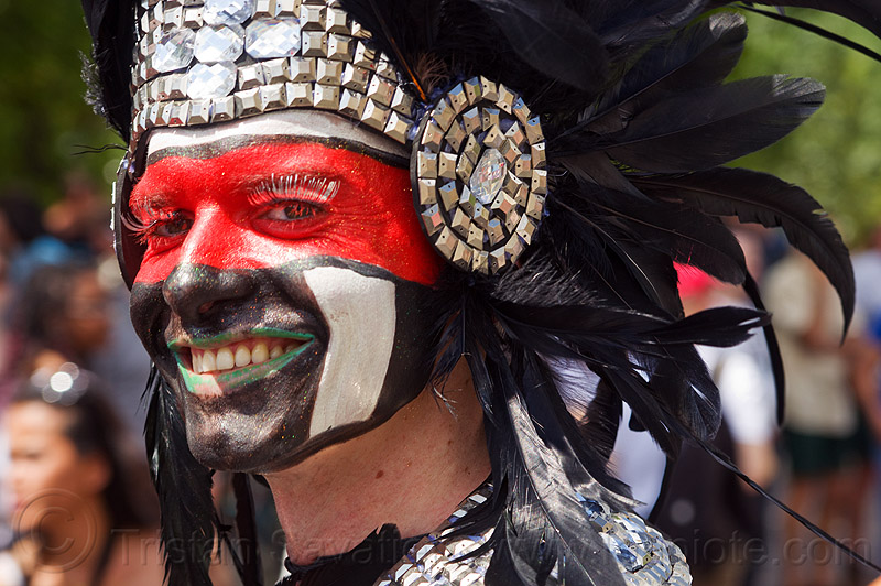 man with aztec dancer headdress, black feathers, costume, facepaint, festival, gay pride, metal, paris, people, red