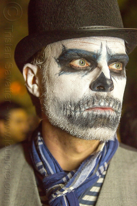 man with dramatic skull makeup, beard, black hat, day of the dead, dia de los muertos, face painting, facepaint, halloween, man, night, scarf, skull makeup