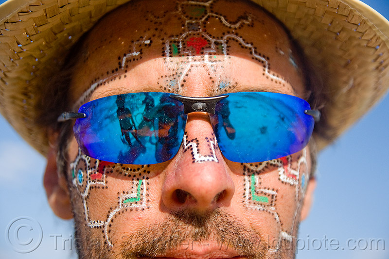 man with face painting - burning man 2009, facepaint, straw hat, sunglasses