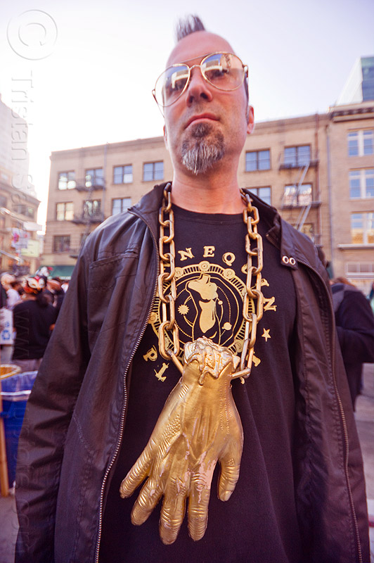 man with golden hand necklace - how weird 2012, golden chain, golden hand, man, necklace