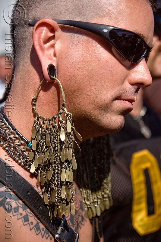 man with large brass earring - dore alley fair (san francisco), brass, ear piercings, earlobe stretched piercing, gauging, jewelry, large earring, man, sunglasses