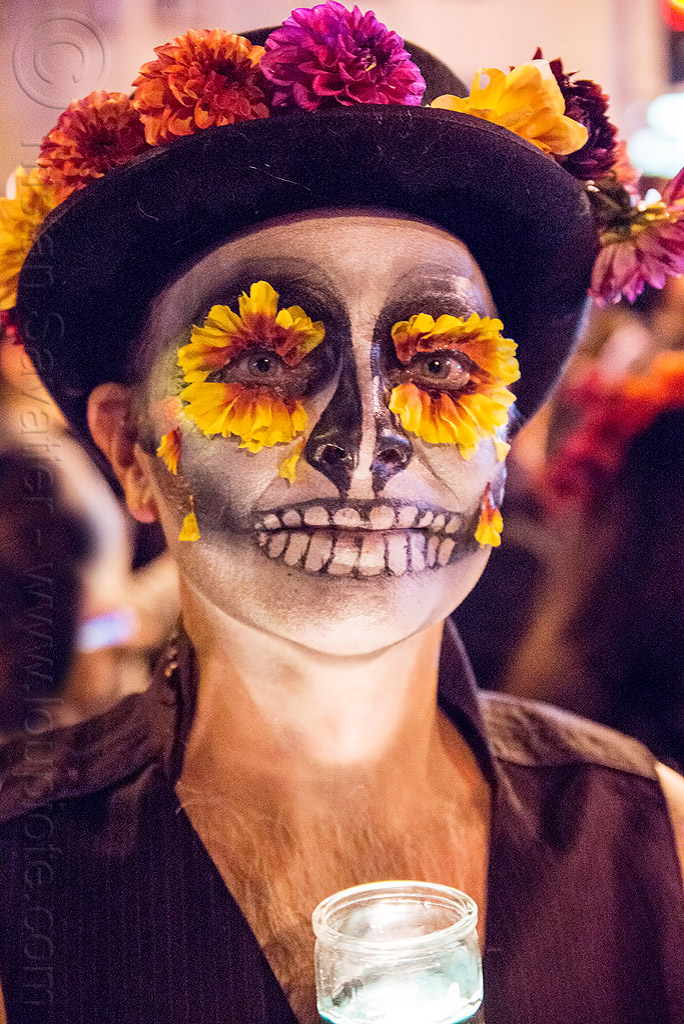 man with marigold flowers eyes and sugar skull makeup -  dia de los muertos, day of the dead, dia de los muertos, eye makeup, face painting, facepaint, flower hat, flower makeup, flowers, glass candle, halloween, man, marigold, night, sugar skull makeup
