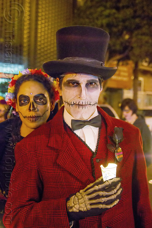 man with skull makeup and red costume - michael paim, bowtie, candle, day of the dead, dia de los muertos, face painting, facepaint, halloween, hands, hat, man, michael paim, night, red color, sugar skull makeup, woman
