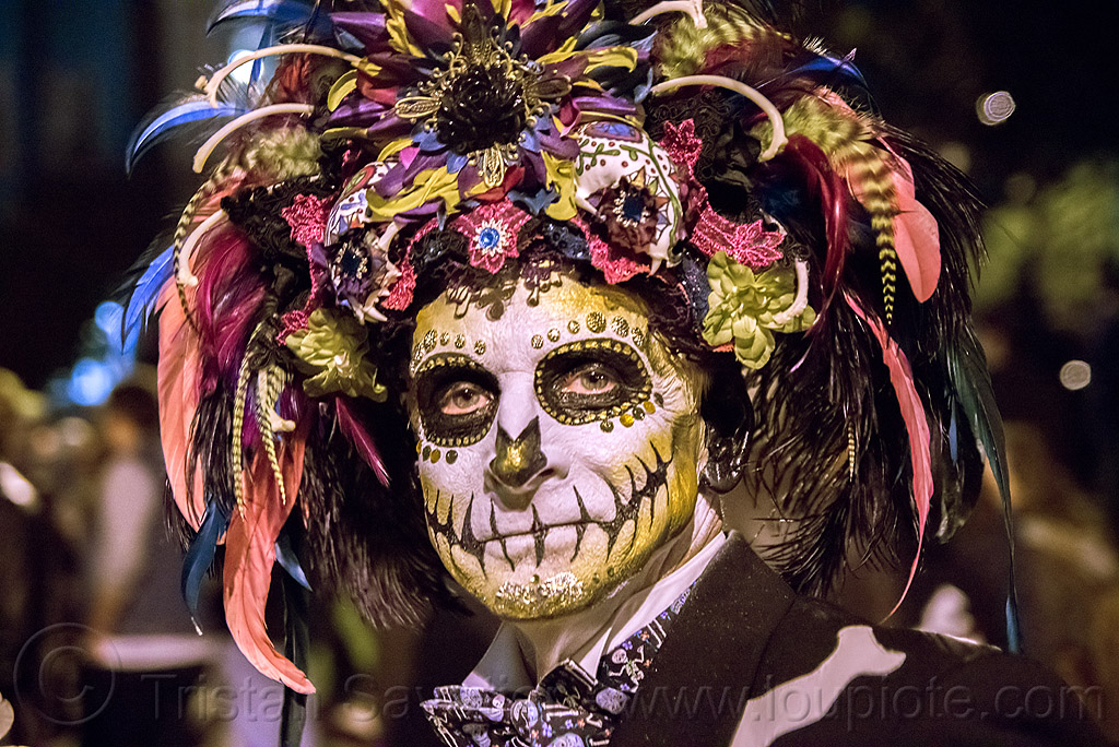 man with sugar skull makeup - large feather headdress - dia de los muertos, bindis, day of the dead, dia de los muertos, face painting, facepaint, feather headdress, feathers, golden, halloween, man, night, sugar skull makeup