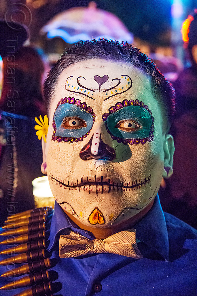 man with sugar skull makeup - white contact lenses - dia de los muertos, bow tie, bullet belt, bullets, color contact lenses, day of the dead, dia de los muertos, halloween, man, night, special effects contact lenses, sugar skull makeup, theatrical contact lenses, white contact lenses, white contacts