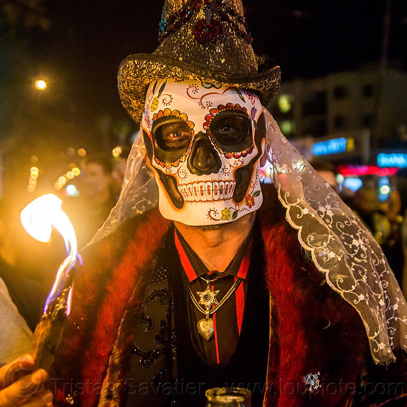 man with sugar skull mask and white lace, burning, day of the dead, dia de los muertos, fire, flame, glittery hat, halloween, necklace, night, people, red, veil
