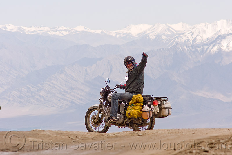 manuel on his motorcycle - khardungla pass - ladakh (india), 350cc, khardung la pass, ladakh, manuel, motorbike touring, motorcycle touring, mountain pass, rider, riding, road, royal enfield bullet