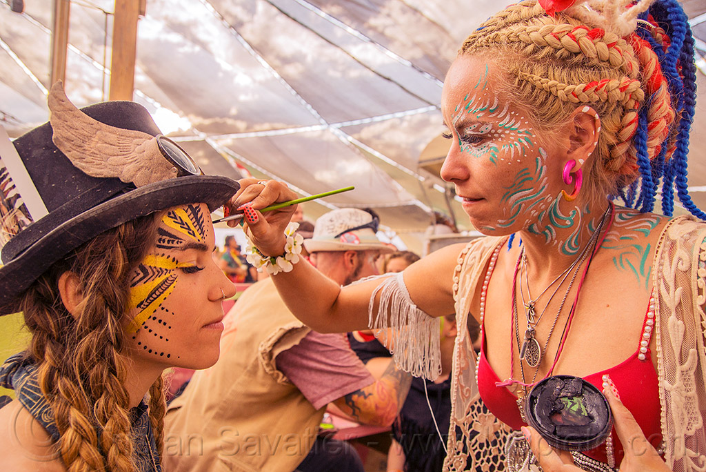 mary-claude getting a face paint - burning man 2016, burning man, center camp, face paint, face painting, hat, mary-claude, women