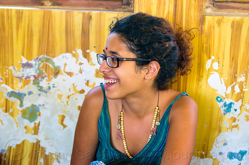 maryam and peeling paint wall, bindi, bracelets, djembe drum, drummer, eyeglasses, eyewear, india, maryam, musical instrument, necklaces, peeling paint, percussion, prescription glasses, rishikesh, sitting, spectacles, woman