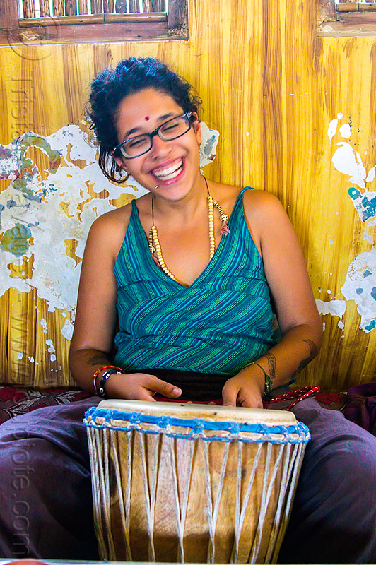 maryam with djembe drum, bindi, bracelets, djembe drum, drummer, eyeglasses, eyewear, india, maryam, musical instrument, necklaces, peeling paint, percussion, prescription glasses, rishikesh, sitting, spectacles, woman