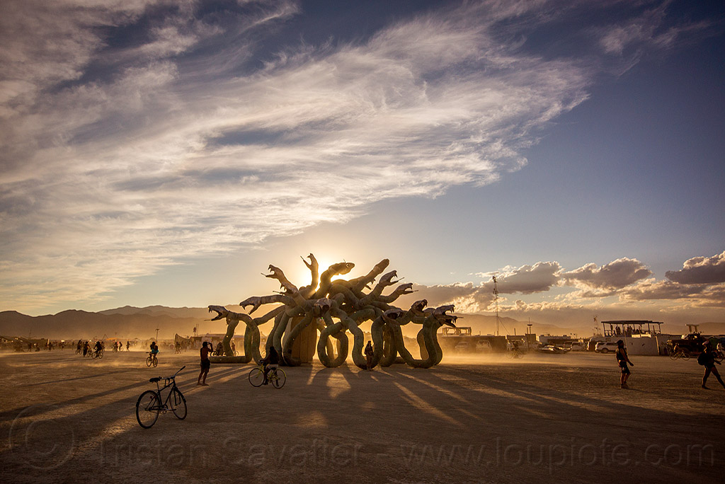 medusa at sunset - burning man 2015, art installation, burning man, clouds, kevin clark, medusa madness, sculpture, shadows, snakes, sunset