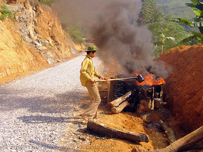 melting asphalt (bitumen) with fire - vietnam, barrels, burning, flames, groundwork, hot asphalt, hot bitumen, macadam, mèo vạc, pavement, paving, people, petroleum, road construction, roadworks