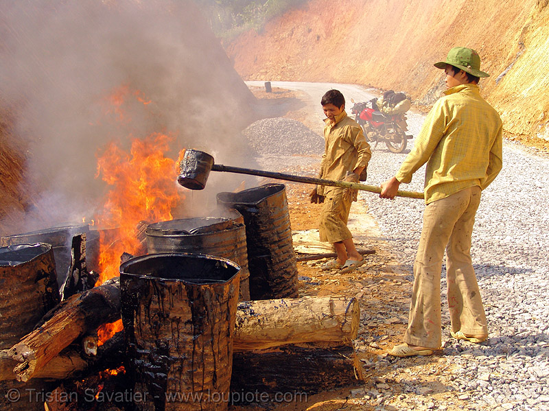 melting asphalt (bitumen) with wood fire - vietnam, air pollution, barrels, burning, environment, flames, groundwork, hot asphalt, hot bitumen, macadam, pavement, paving, people, petroleum, road construction, roadworks