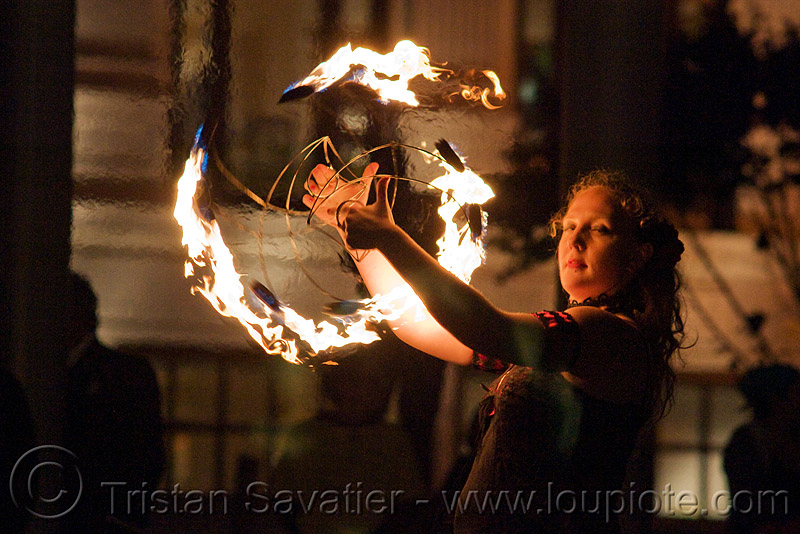 memory with fire fans - fire performer - temple of poi 2009 fire dancing expo - union square (san francisco), fire dancer, fire dancing expo, fire fans, fire performer, fire spinning, lena, memory, night, pyrotation, spinning fire, temple of poi, woman