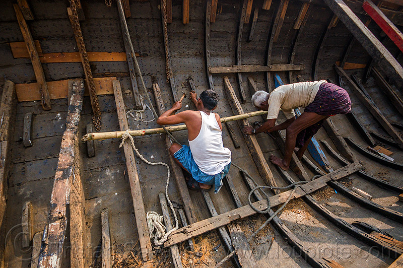 men repairing hull of wooden river boat, fixing, hull, india, men, repairing, river boat, varanasi, working