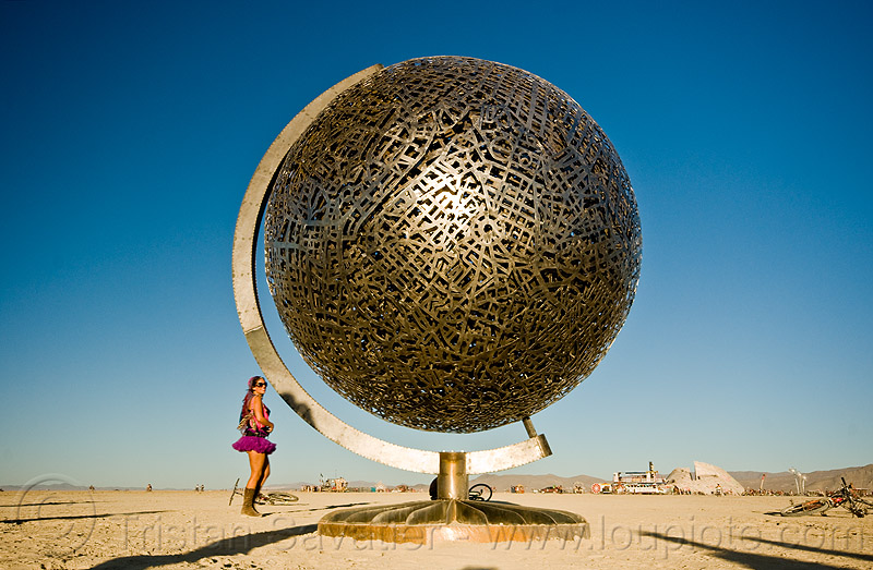 metal globe, art installation, ball, burning man, earth, globe, greta, metal sculpture, michael christian, playa, sphere, steel, woman