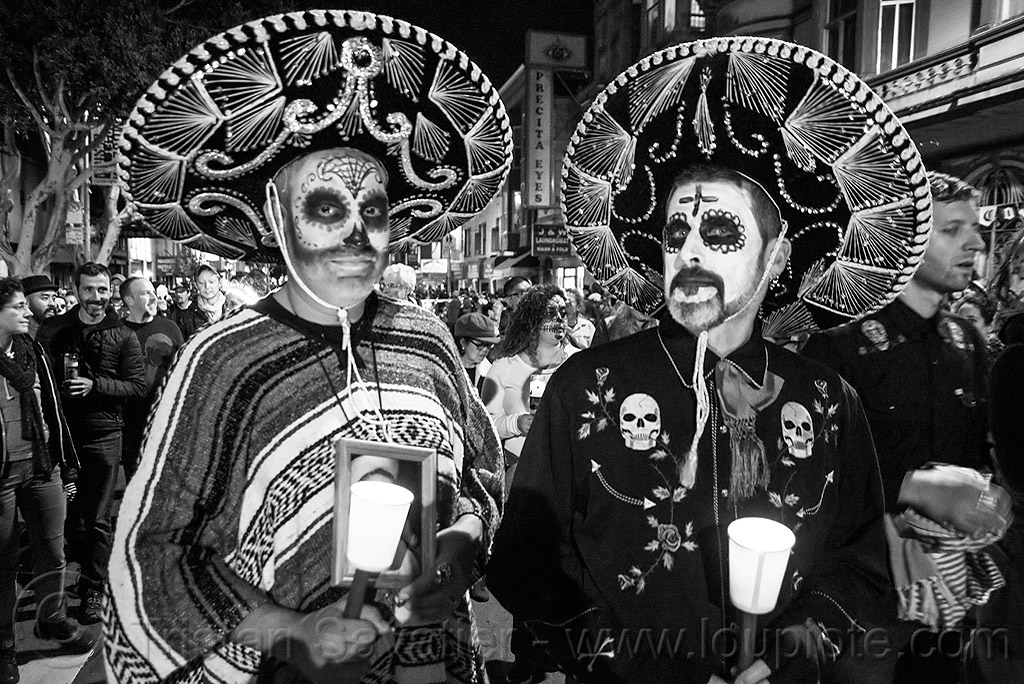 mexican costumes - two men with sombreros and sugar skull makeup - dia de los muertos, candles, day of the dead, dia de los muertos, face painting, facepaint, halloween, men, mexican hats, night, poncho, skulls, sombreros, sugar skull makeup, two