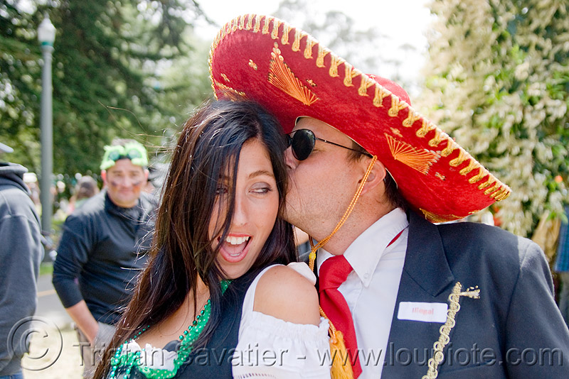 mexican couple, bay to breakers, costume, festival, footrace, hat, kissing, man, people, red, red sombrero, street party, woman