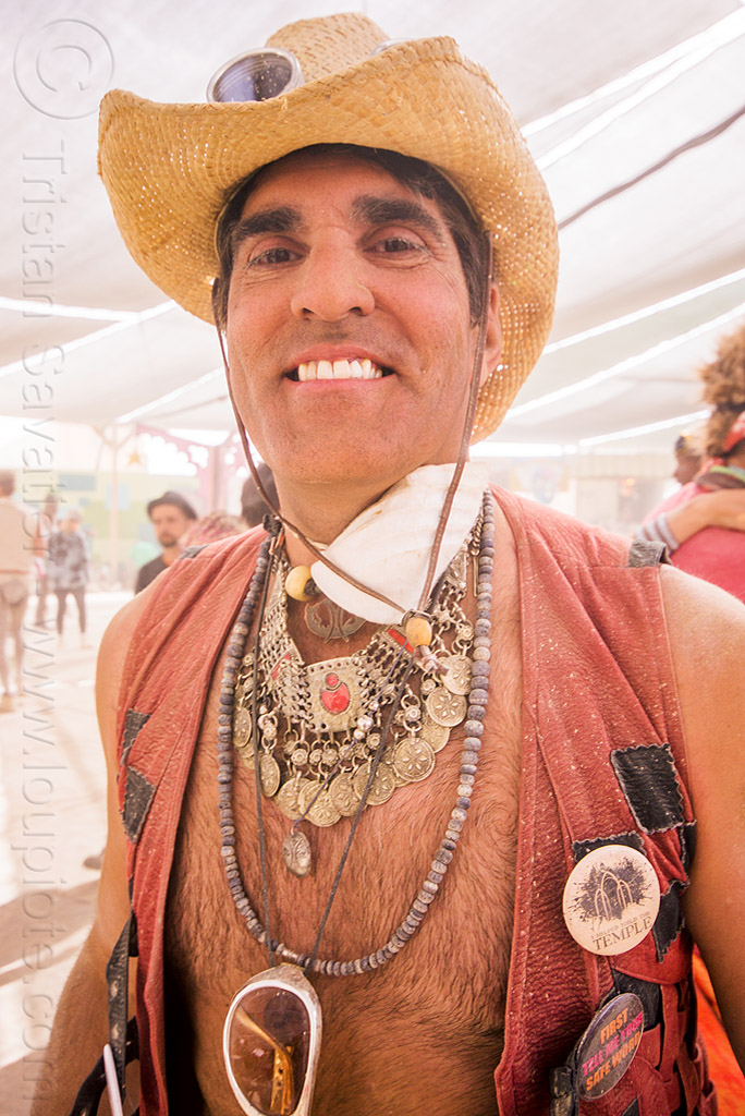 michael at center camp - burning man 2015, burning man, metal necklace, necklaces, straw hat
