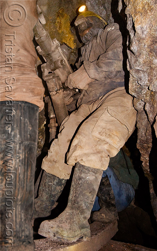 mine worker with drill, bolivia, cerro rico, compressed air, drilling, fuses, fuzes, man, mina candelaria, mine tunnel, mine worker, miner, mining, potosí, power drill, respirator, rubber boots, safety helmet, underground mine