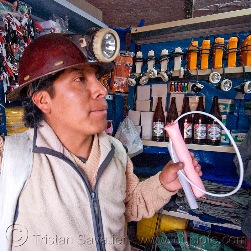 miner buying dynamite and ammonium nitrate (ANFO) at the corner store - potosi (bolivia), blasting caps, candelaria, cerro rico, dinabol, dynamite stick, explosive, fertilizer, flash lights, fuses, fuzes, man, mina, mina candelaria, mine, mine worker, mining, people, potosí, safety helmet, sticks