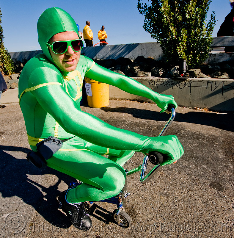 mini bike - green man - superhero street fair (san francisco), green costune, islais creek promenade, man, mini bike, sunglasses, superhero street fair