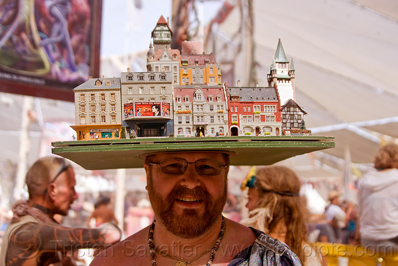 miniature city block hat, beard, buildings, burning man, canter camp cafe, center camp, city block, cityscape, eyeglasses, eyewear, hat, headdress, headwear, houses, miniature, model, prescription glasses, spectacles