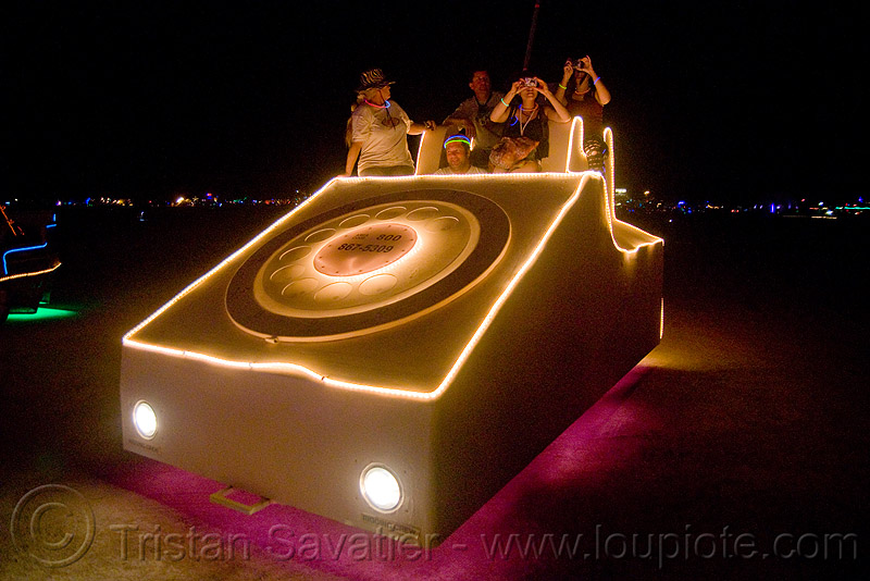 mobile phone - it's illegal to use a phone while driving - burning man 2009, art car, art car camp, damon doherty, night, people, phonesaure, telephone