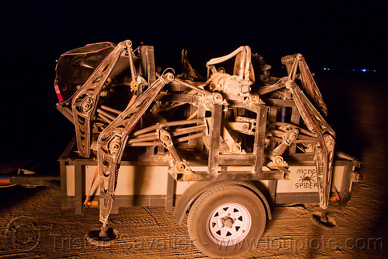 mondo spider on its trailer - burning man 2009, arachnide, art car, biomimicry, hydraulic, legs, machinery, mechanical spider, motorized spider, night, walker, walking machine