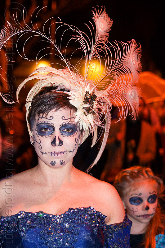 mother and daughter with sugar skull makeup - white feather headdress, blue dress, child, daughter, day of the dead, dia de los muertos, face painting, facepaint, feather headdress, halloween, kid, mother, night, sugar skull makeup, white feathers