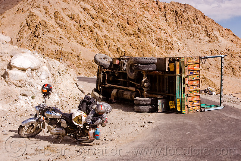 motorcycle and overturned truck - khardungla pass - ladakh (india), accident, bullet, crash, khardung, khardung la, khardung la pass, lorry, motorbike, motorbike touring, motorcycle touring, mountain pass, mountains, road, royal enfield, tata, tata motors, traffic accident, truck accident, underbelly, wreck