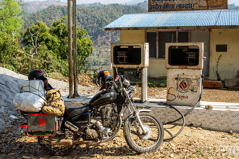 motorcycle at abandoned gas station (nepal), 350cc, bags, gas pump, gas station, luggage, motorcycle touring, petrol pump, petrol station, royal enfield bullet, thunderbird
