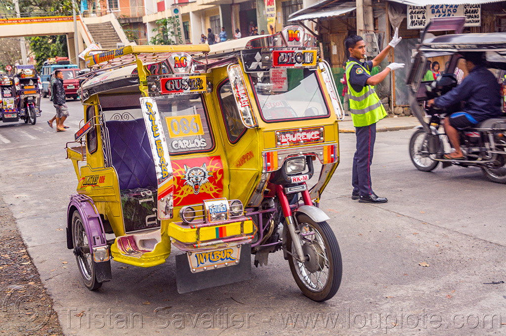 motorized tricycles - bontoc (philippines), bontoc, man, motorbikes, motorcycles, motorized tricycles, philippines, policeman, public transportation, reflective vest, safety vest, sidecar, standing, street, traffic police