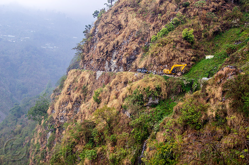 mountain road along cliff in sikkim (india), excavator, mountains