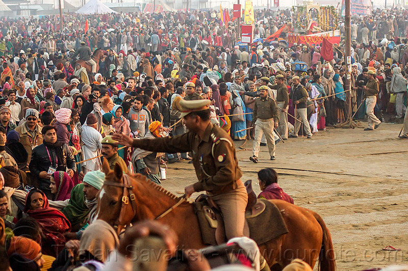 mounted police clearing access to sangam bathing area - kumbh mela (india), cops, crowd control, dawn, horse riding, horseback riding, kumbh maha snan, kumbha mela, maha kumbh mela, mauni amavasya, mounted police, police horses, police officers, triveni sangam