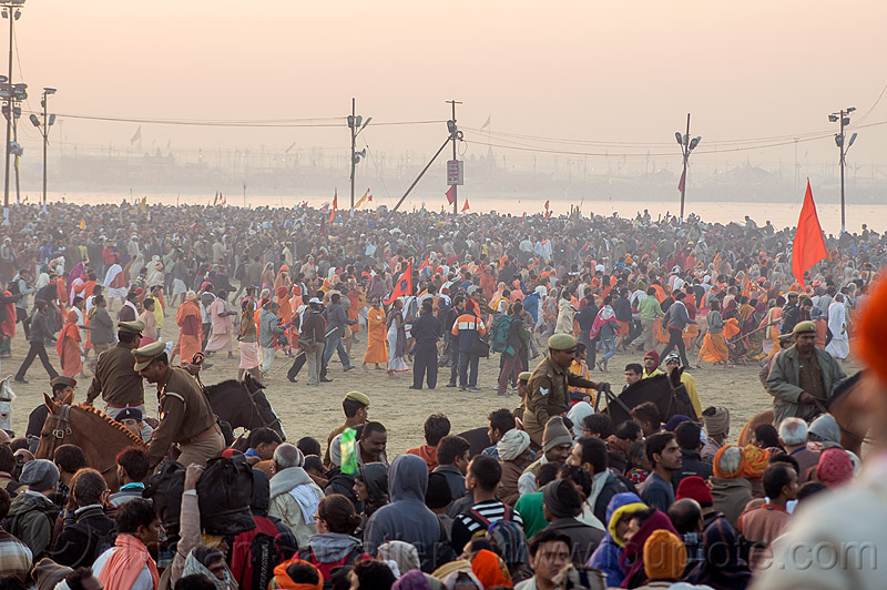 mounted police clearing access to sangam bathing area - kumbh mela (india), cops, crowd control, dawn, hindu pilgrimage, hinduism, india, kumbh maha snan, maha kumbh mela, mauni amavasya, mounted police, police horses, police officers, triveni sangam