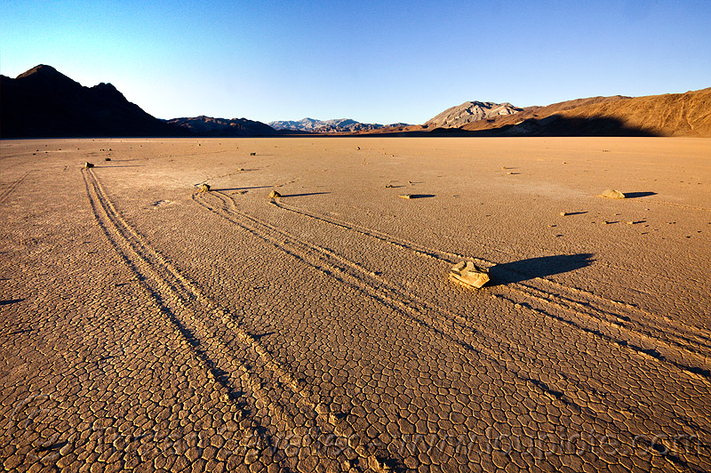 moving rocks on the racetrack - death valley, cracked mud, death valley, desert, dry lake, dry mud, mountains, racetrack playa, sailing stones, sliding rocks, tracks